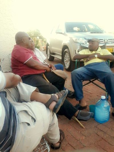 My dad and uncles chatting... Hanging Out