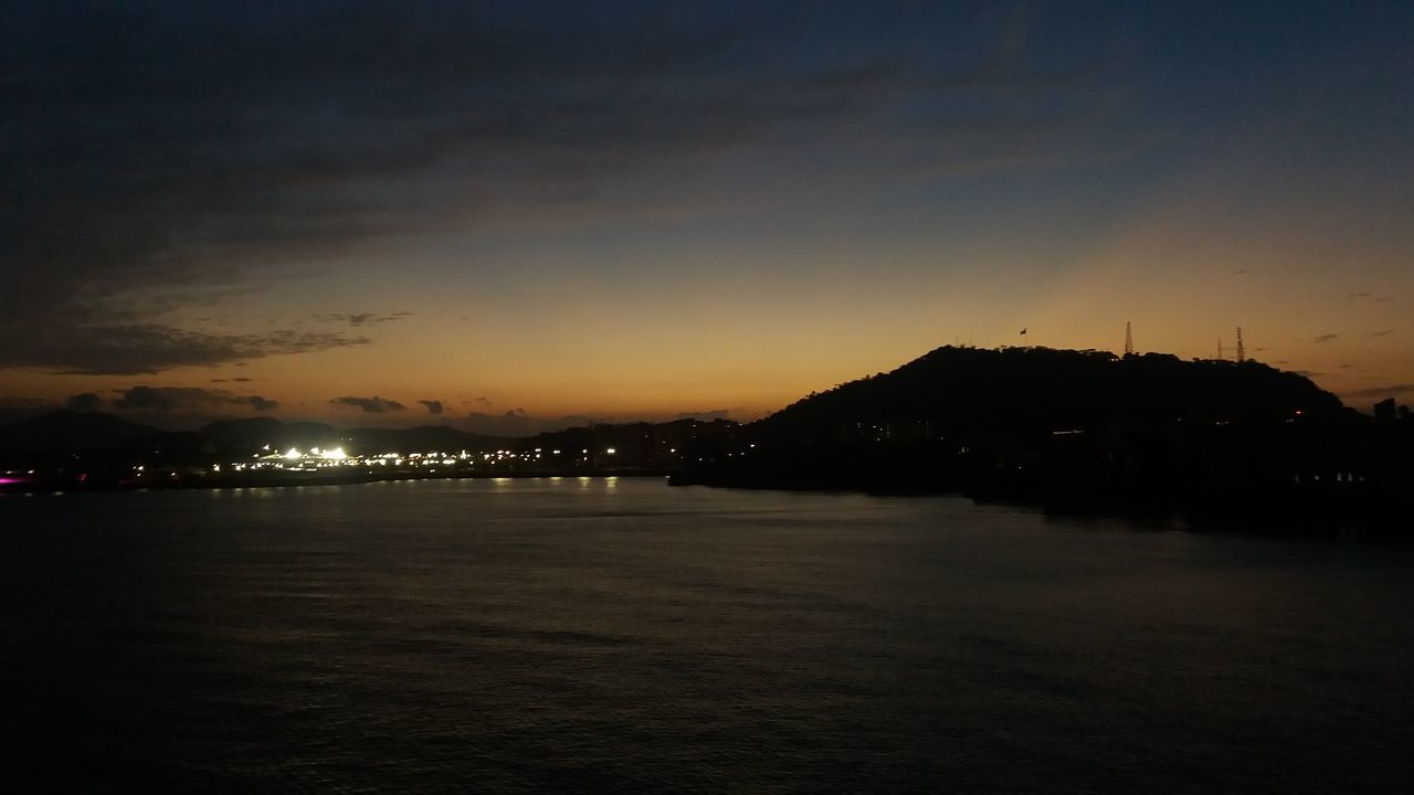 sunset, silhouette, no people, night, sky, nature, sea, water, scenics, beauty in nature, illuminated, outdoors, city
