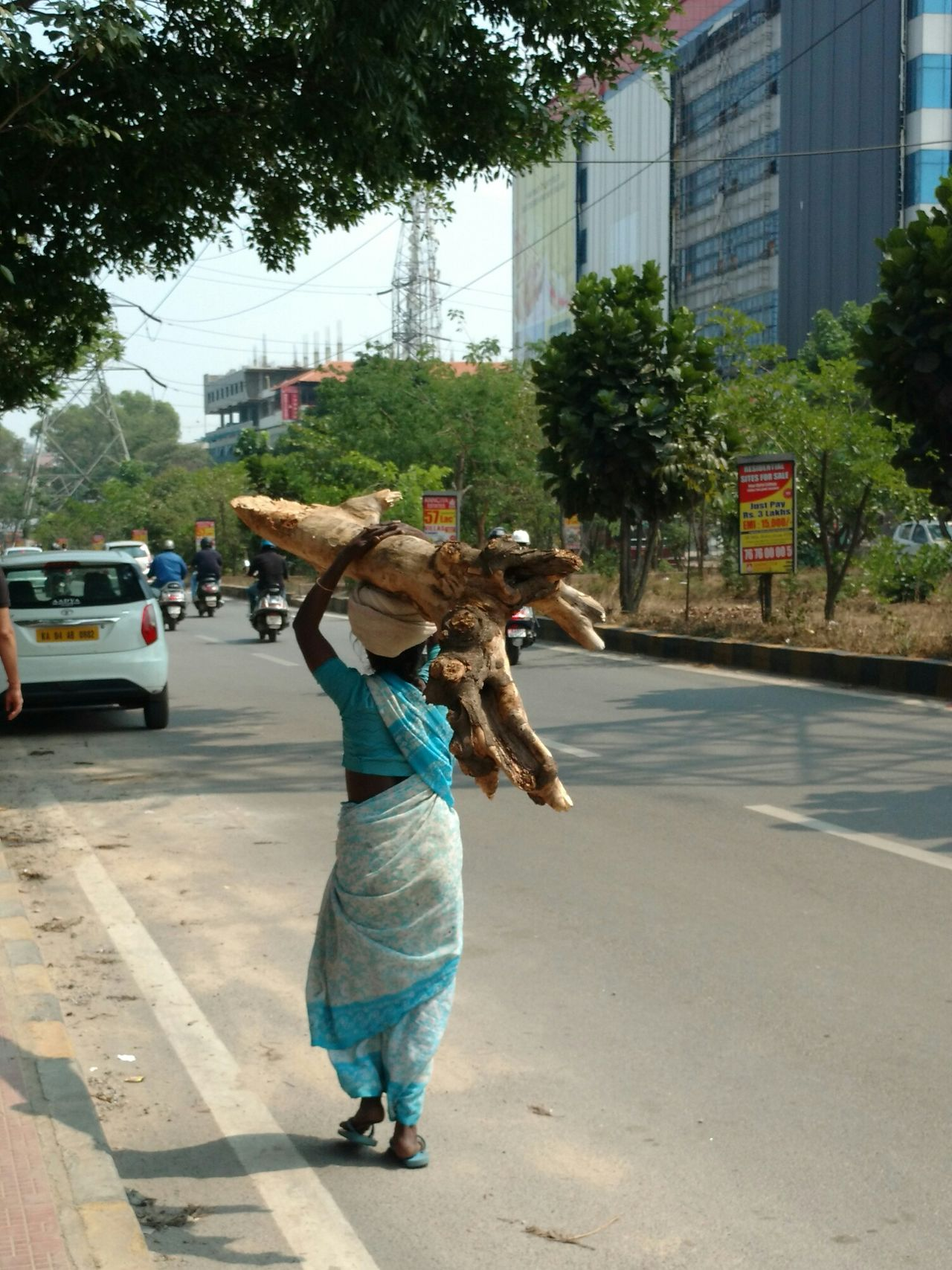 The Street Photographer - 2017 EyeEm Awards People Women Motion Outdoors Tree Real People Full Length One Woman Only Sunny Afternoon Hardworking Adult South India Road One Person Indian Stories Street Day Workers At Work Survivorship Survivors Inspiring City Life Migrant Workers