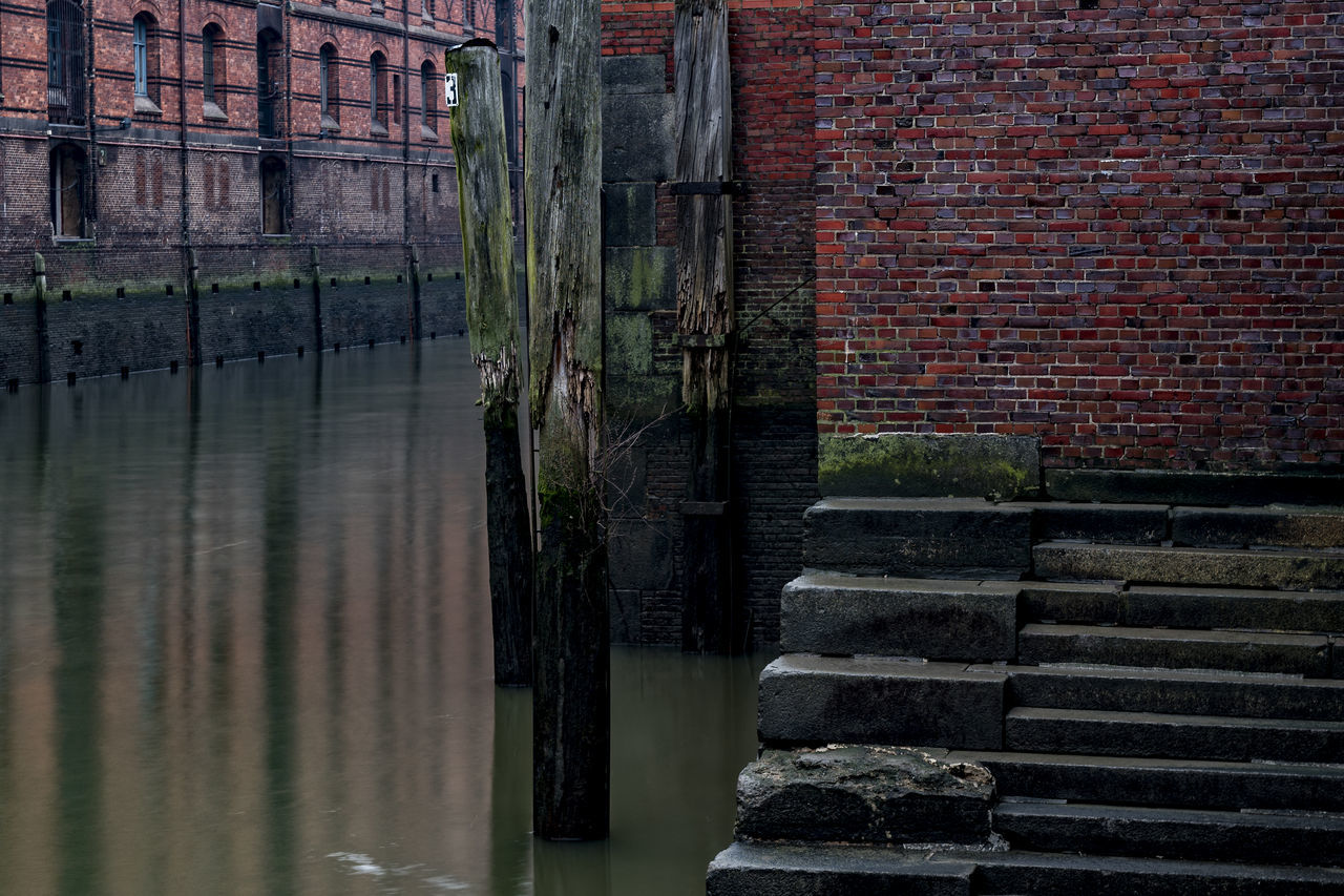 Speicherstadt Hamburg Adapted To The City Architecture Brick Wall Bricks Building Exterior Built Structure Day Fleet Hamburg Hamburg Harbour January 2017 Morning Nature No People North Germany Old Buildings Outdoors Reflektions Speicherstadt Hamburg Stairs Unesco World Heritage Walls Water