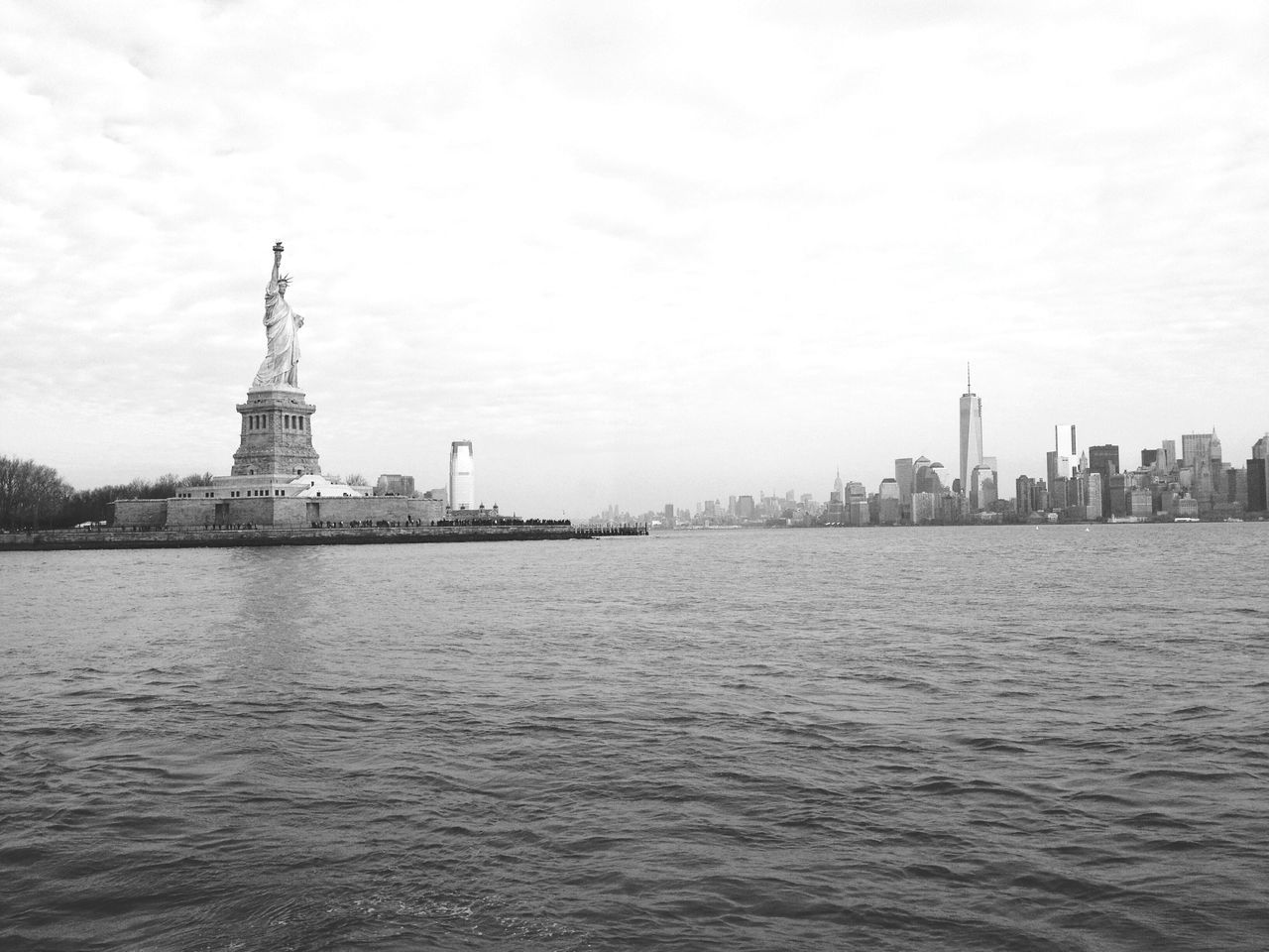 Statue Of Liberty Amidst Sea Against Sky