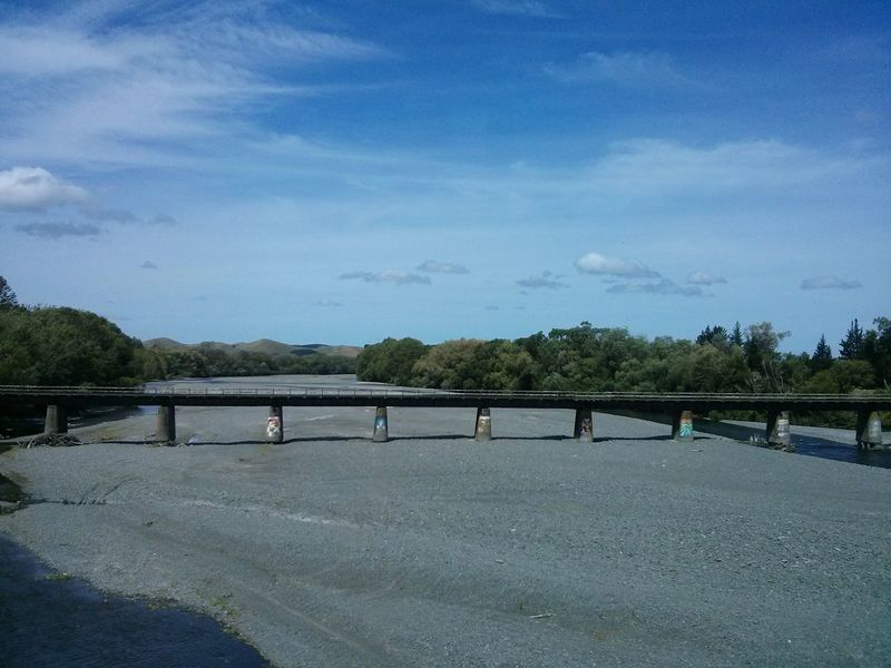 passing a bridge over no water. · new zealand landscape Nature Architecture sunny day blue sky Traveling