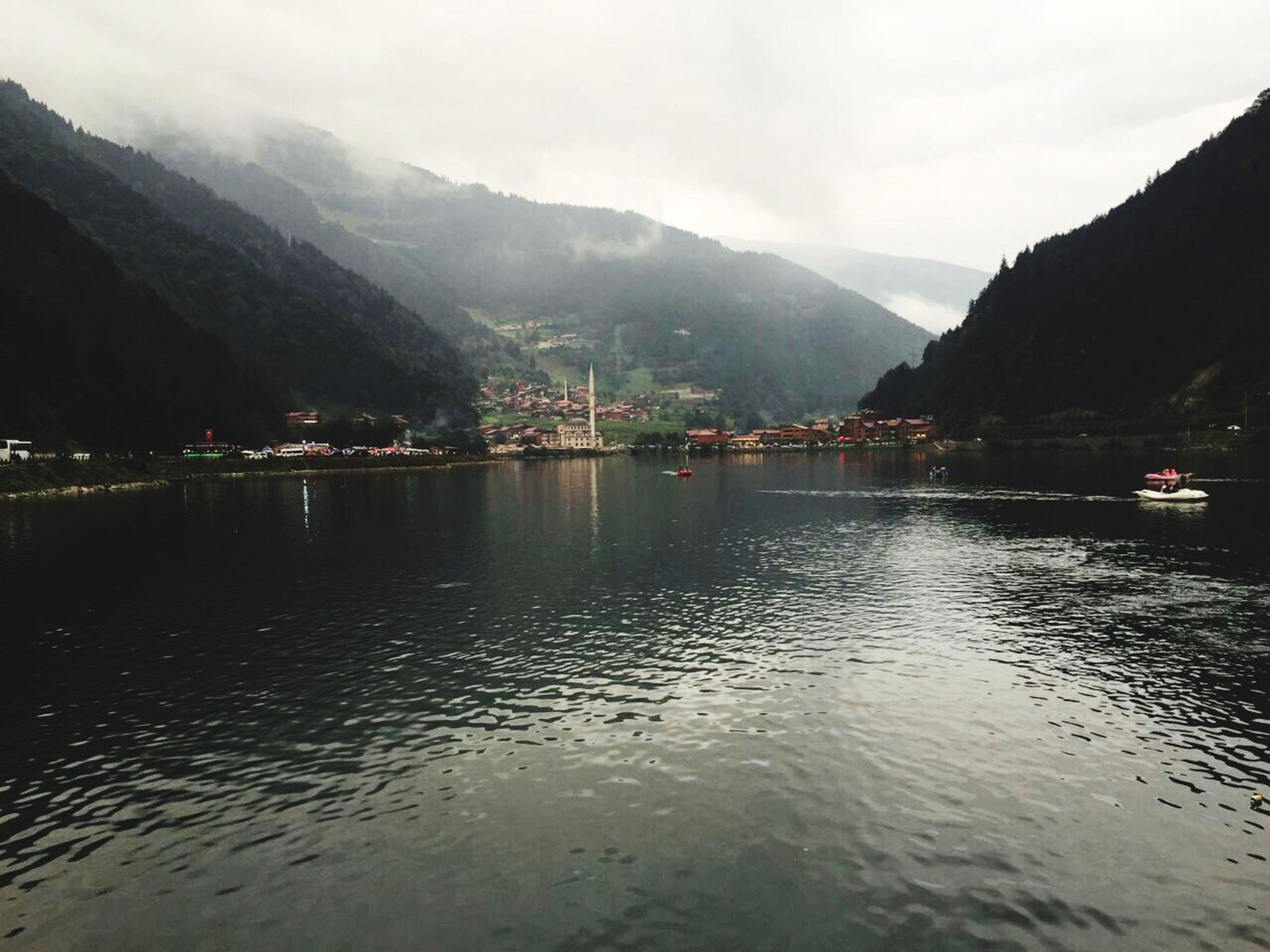 mountain, water, waterfront, reflection, mountain range, tranquility, tranquil scene, scenics, sky, travel destinations, town, cloud, nature, non-urban scene, cloud - sky, beauty in nature, day, water surface, outdoors, vacations, tourism, harbor, no people