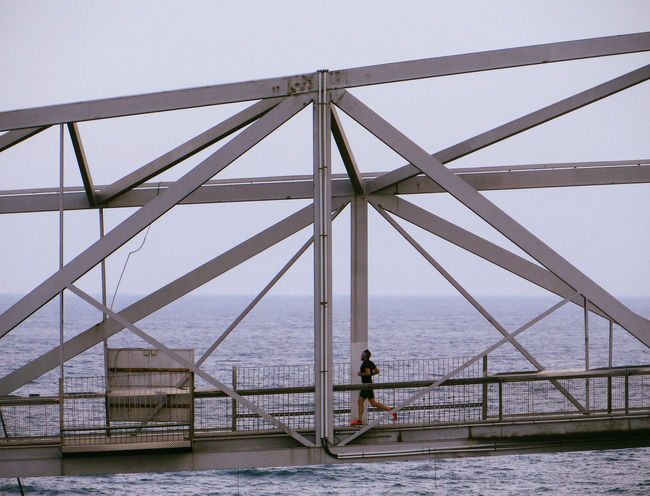 Adult Adults Only Architecture Bridge - Man Made Structure Built Structure Connection Day Full Length Men Nature One Man Only One Person Only Men Outdoors People Real People Runner Runners Running Sea Sky Spots Vacations Water Young Adult