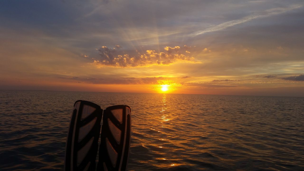 With the bellyboat on the baltic sea Bellyboat Gone Fishing Sunset Sea Water Horizon Over Water Sun Scenics Rippled Tranquil Scene Beauty In Nature Tranquility Orange Color Dramatic Sky Sky Reflection Seascape Cloud Atmospheric Mood Nature Vacations Atmosphere Live For The Story
