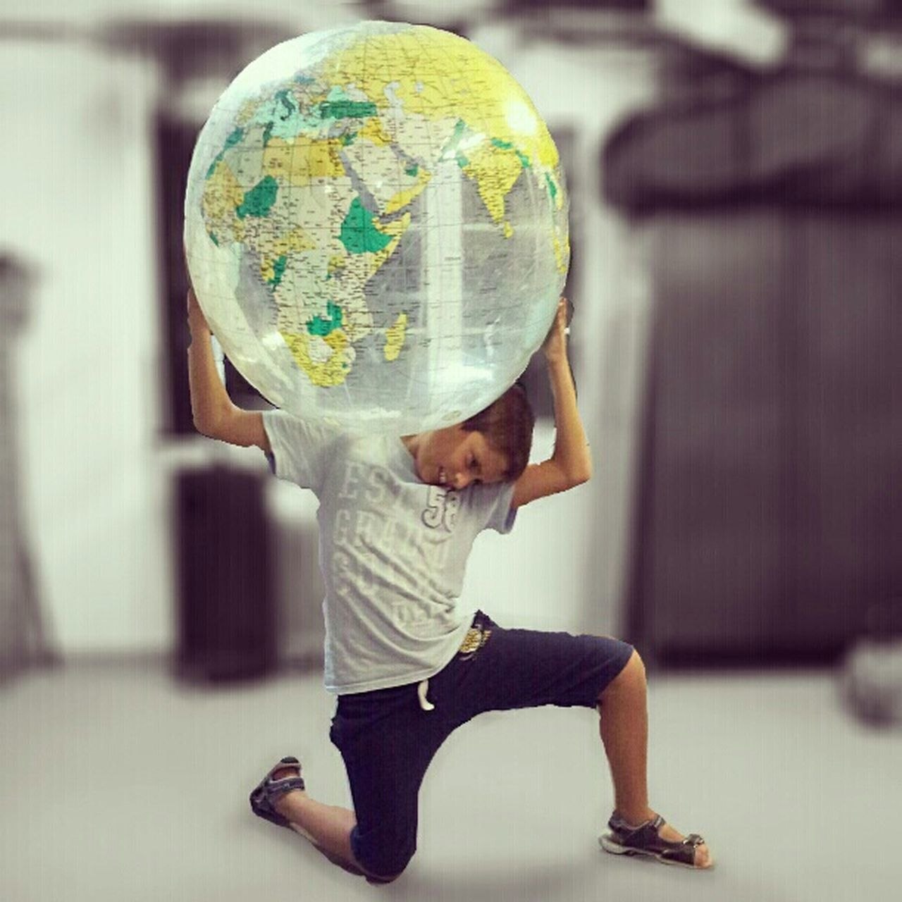 one person, planet - space, futuristic, casual clothing, full length, childhood, indoors, child, children only, people, planet earth, one boy only, males, space, education, boys, standing, space exploration, technology, adult, day, astronomy, space suit
