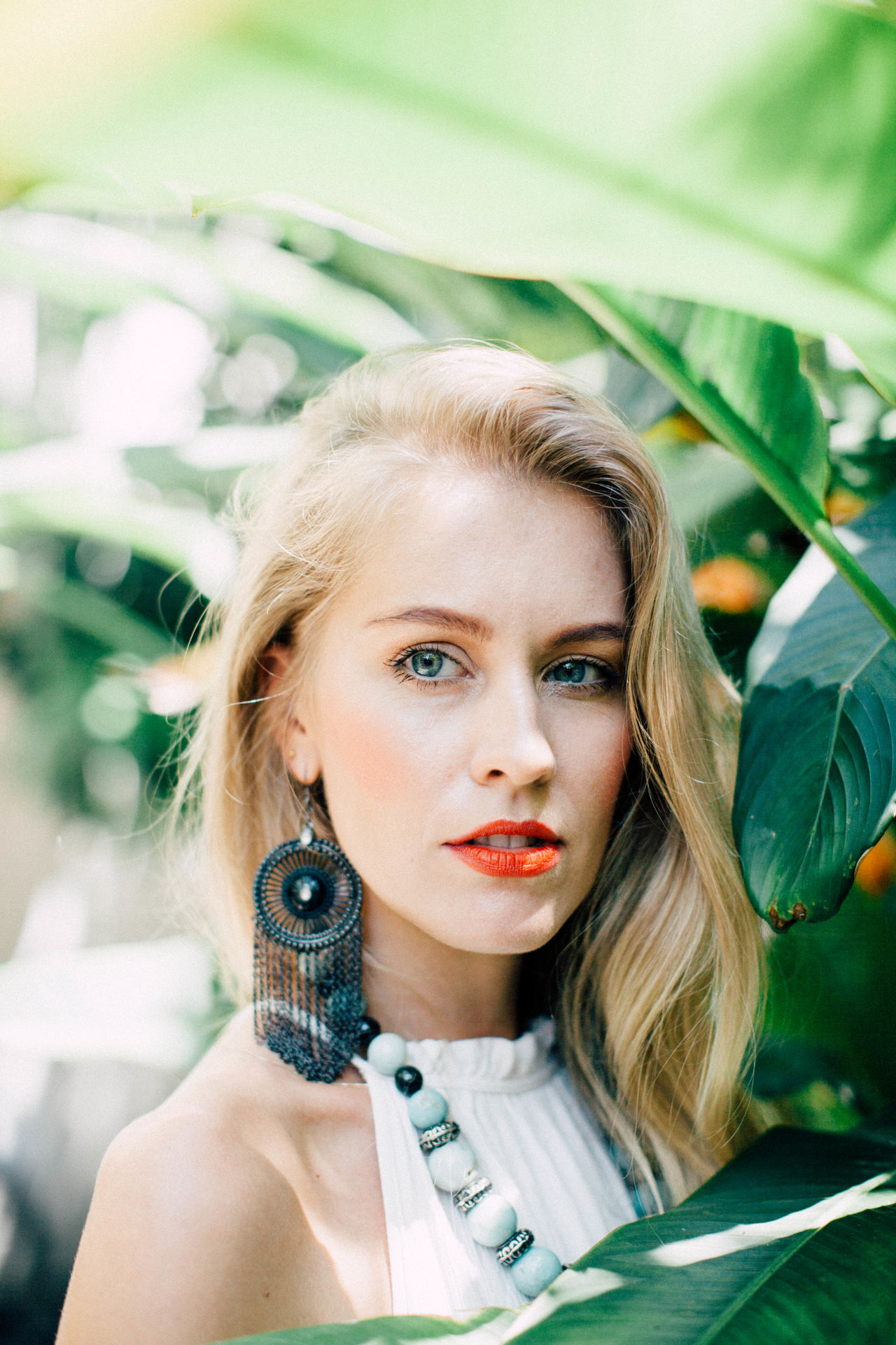 Beautiful People Beautiful Woman Beauty Blond Hair Close-up Day Fashion Fashion Model Glamour Headshot Human Lips Leaf Lifestyles Lipstick Looking At Camera One Person One Woman Only One Young Woman Only Outdoors Portrait Real People Red Lipstick Women Young Adult Young Women