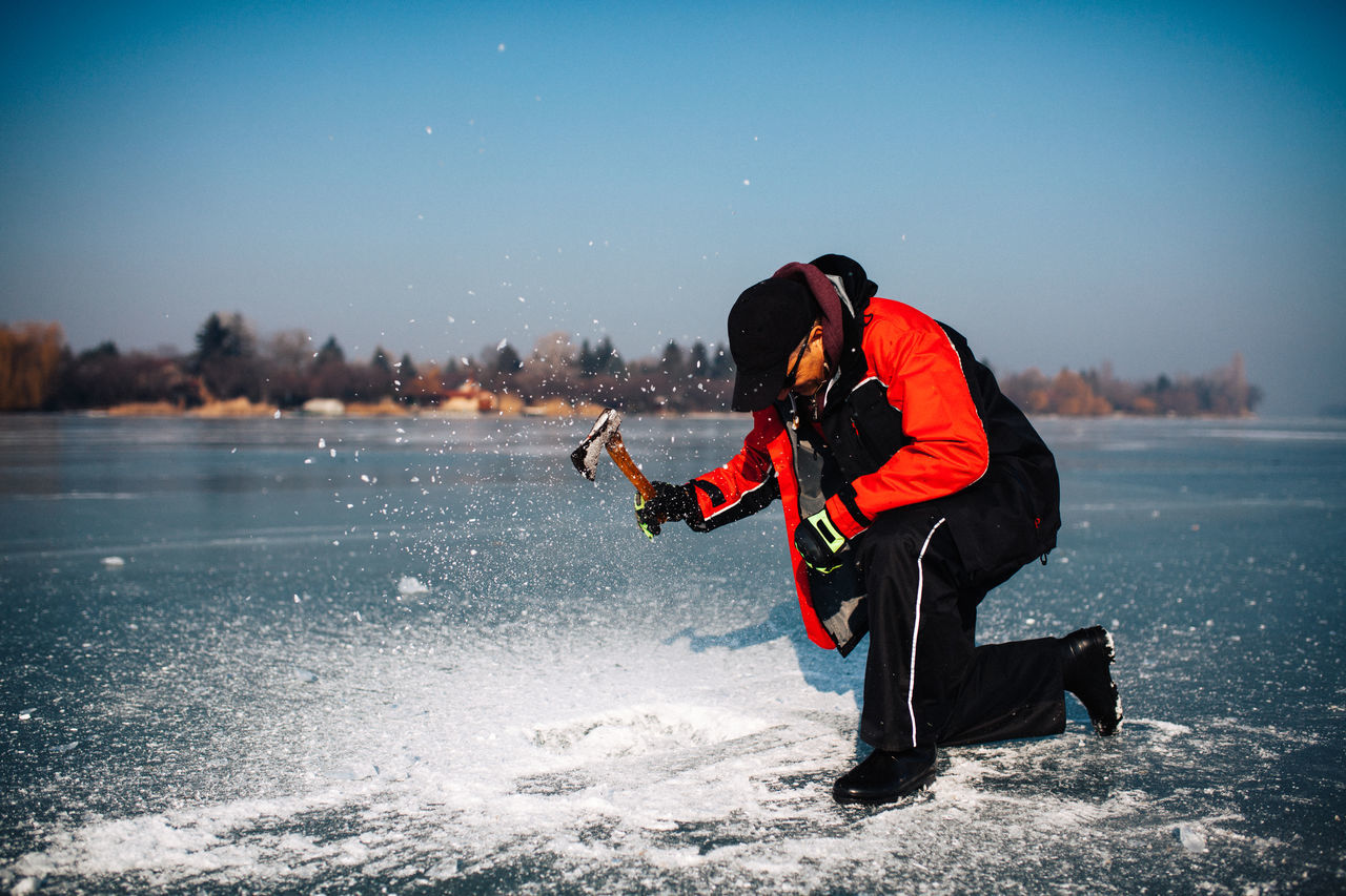 On ice Adventure Axe Beauty In Nature Cold Temperature Extreme Sports Fastshutter Fishing Freezing Healthy Lifestyle Ice Icefishing Leak Leisure Activity Lifestyles Motion Nature One Man Only One Person Onice Outdoors Snow TeamCanon Water Winter Winter Sport