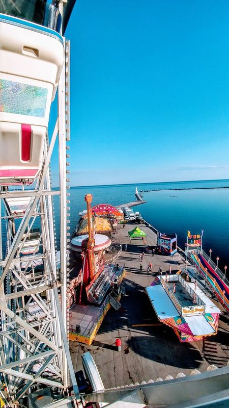 Fairground Attractions Beach Water Outdoors Horizon Over Water Clear Sky Blue Fairground Ride EyeEm Selects Ferris Wheel Color Photography