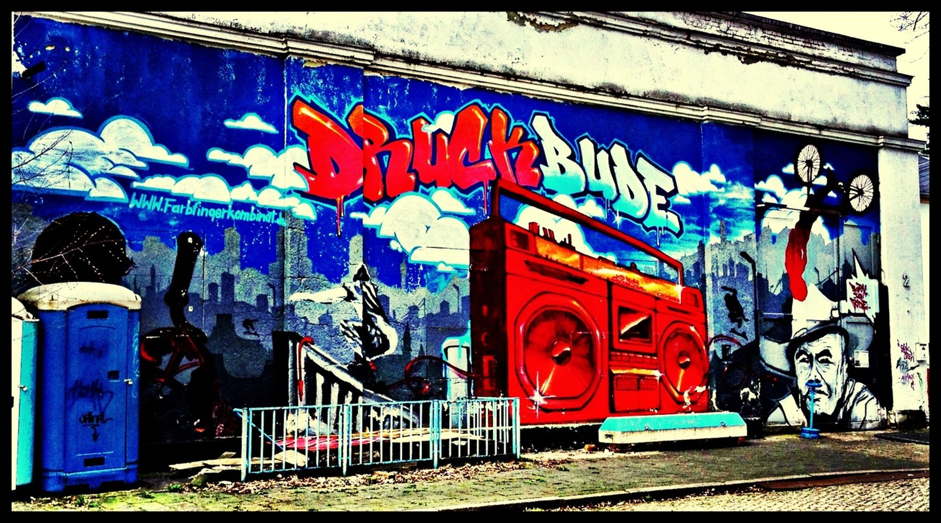 graffiti, art, creativity, art and craft, wall - building feature, built structure, architecture, multi colored, building exterior, blue, street art, text, wall, western script, vandalism, communication, day, auto post production filter, outdoors, mural