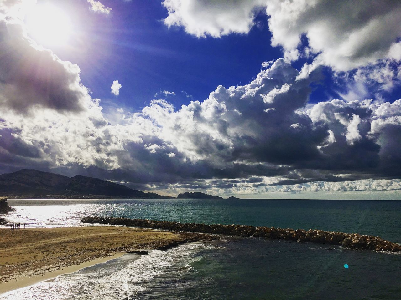 sky, beauty in nature, cloud - sky, water, scenics, nature, sea, tranquility, tranquil scene, sunlight, outdoors, no people, day