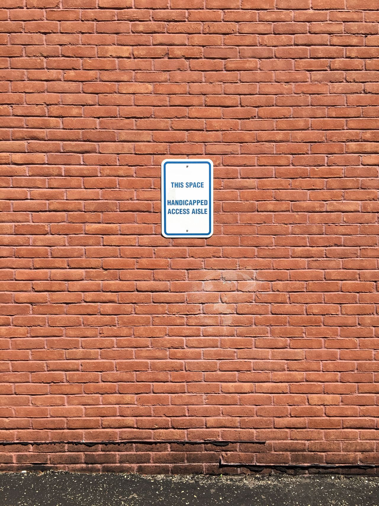 Disabled Access. Parking Lot Park Disabled Person Government Disability Parking Signs Law Accessibili Accessibilité Regulations Minimalist Minimal Minimalism Warm Assist Handicap Parking Outside Exterior Building Wall Brick Handicapped Sign Handicap Car Disabilities Access