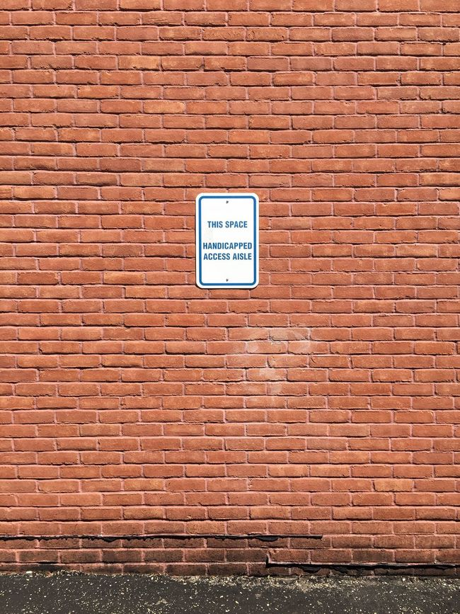 Disabled Access. Parking Lot Park Disabled Person Government Disability Parking Signs Law Accessibili Accessibilité Regulations Minimalist Minimal Minimalism Warm Assist Handicap Parking Outside Exterior Building Wall Brick Handicapped Sign Handicap Car Disabilities Access