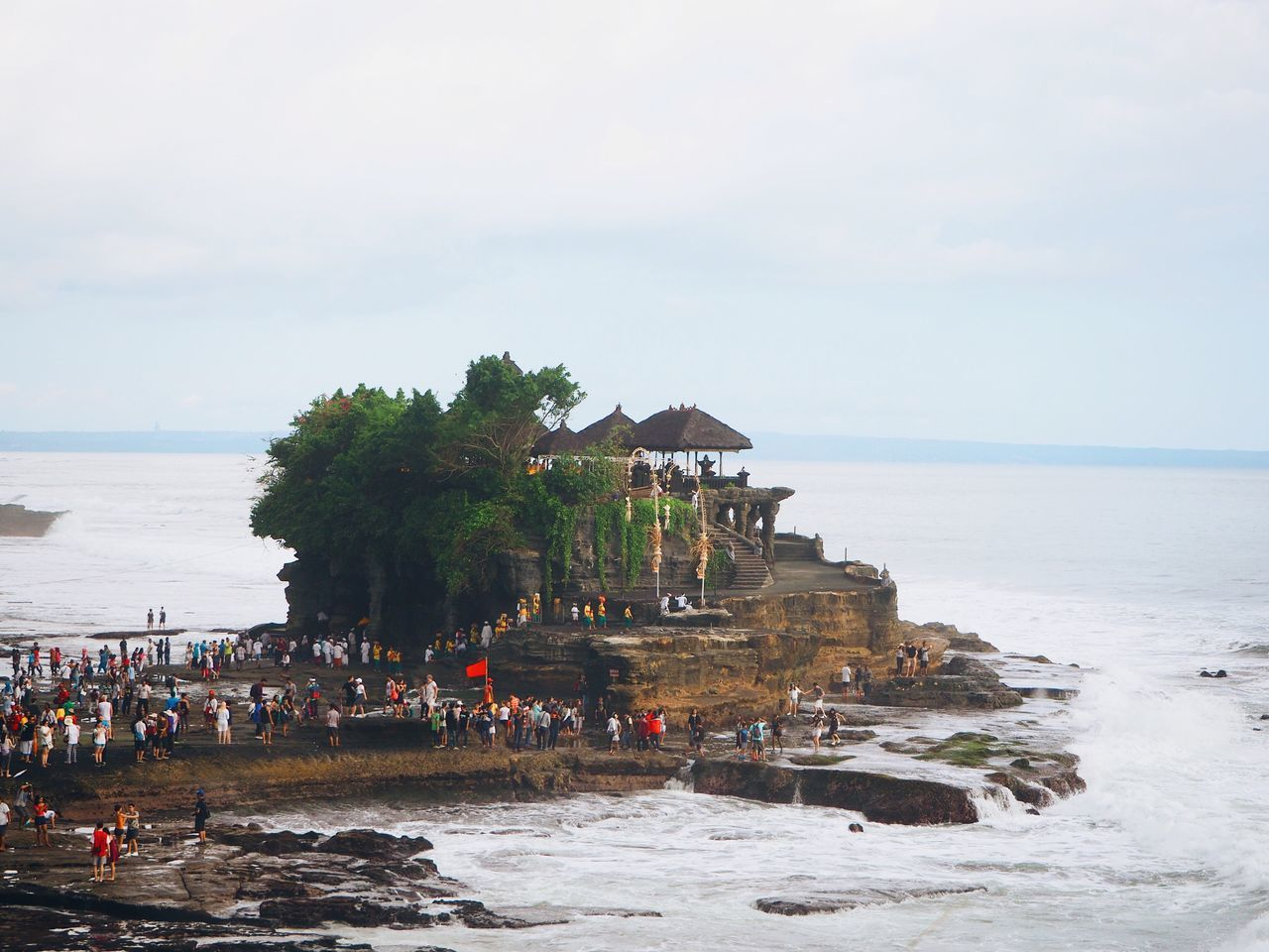 Sea Large Group Of People Water Horizon Over Water Beach Nature Sky Vacations Tourism Travel Destinations Leisure Activity Scenics Outdoors Day Built Structure Real People Architecture Beauty In Nature Cloud - Sky Building Exterior Bali, Indonesia Tanah Lot