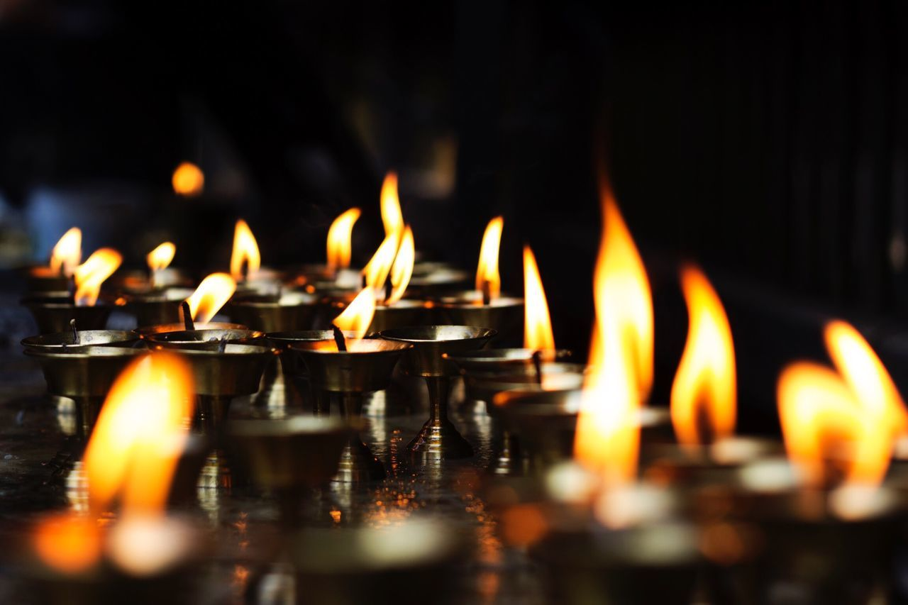 flame, burning, candle, religion, heat - temperature, spirituality, selective focus, place of worship, reflection, illuminated, no people, large group of objects, close-up, indoors, night, diya - oil lamp