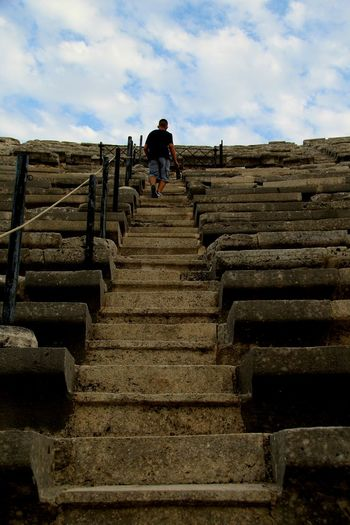 Steps And Staircases Steps Staircase Low Angle View Sky Rear View The Way Forward Lifestyles Men Leisure Activity Cloud - Sky Railing Moving Up Day Outdoors Cloud Travel Destinations Stairs Stone Material Tourism