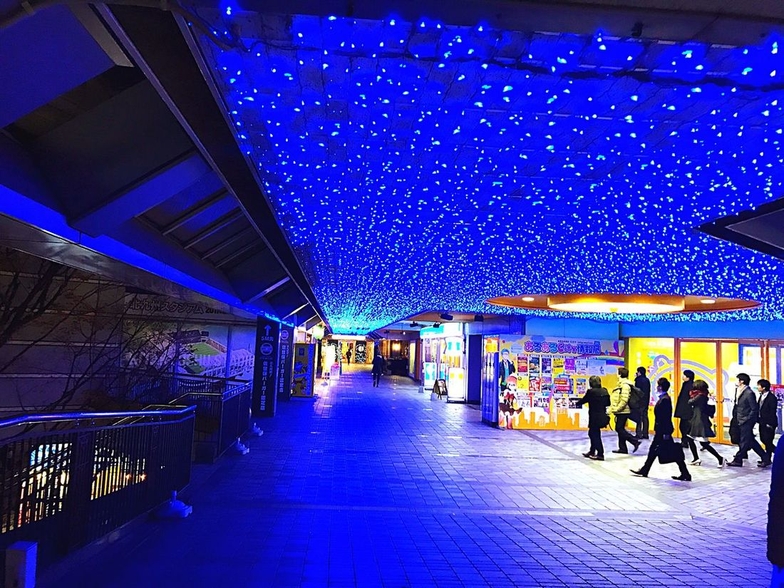 Illuminated Blue Architecture Real People Built Structure Night City Large Group Of People Men People Indoors  Sky Adults Only Adult