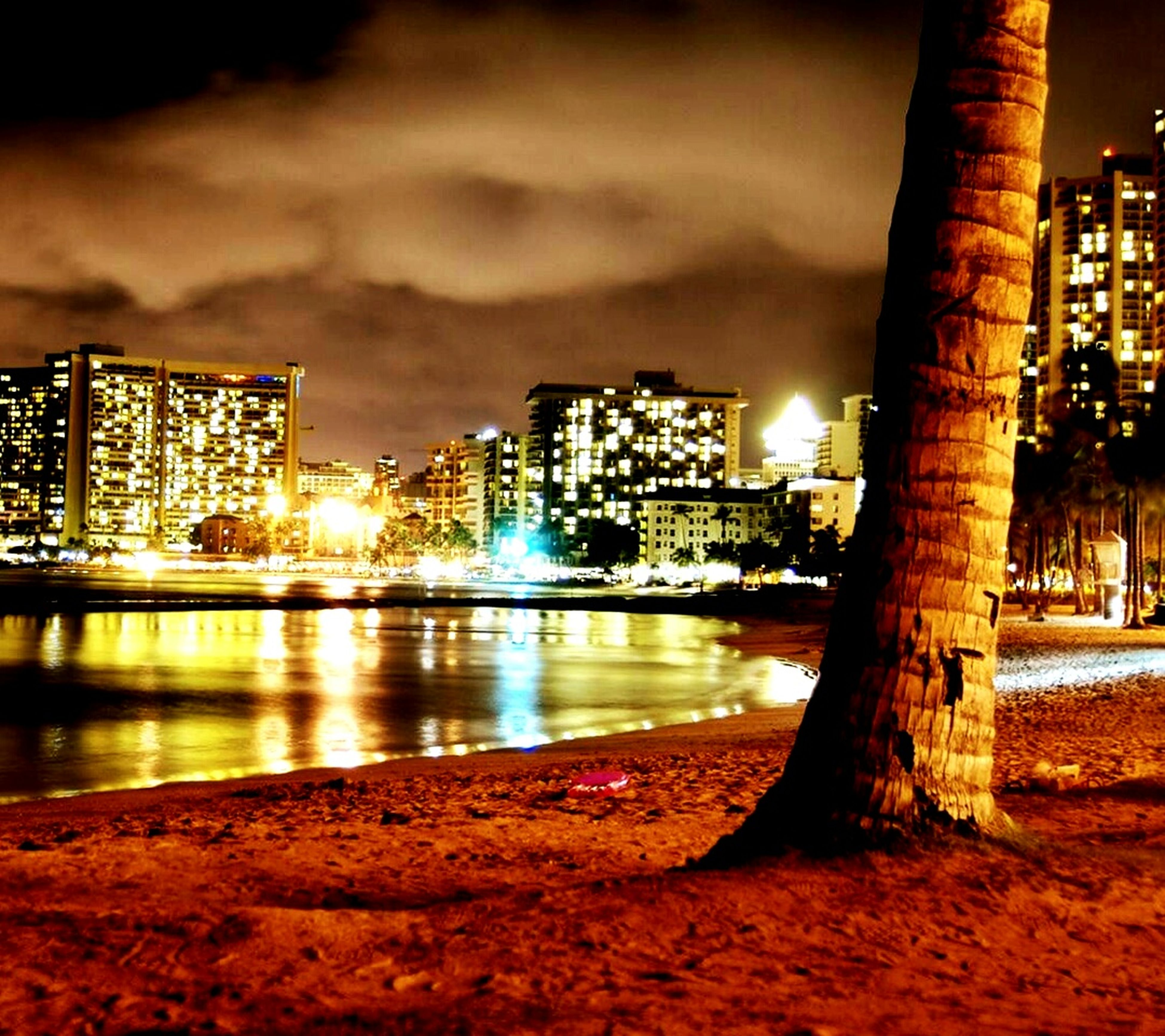 illuminated, night, building exterior, architecture, city, built structure, cityscape, sky, water, reflection, skyscraper, river, residential building, building, modern, waterfront, tall - high, office building, urban skyline, light - natural phenomenon