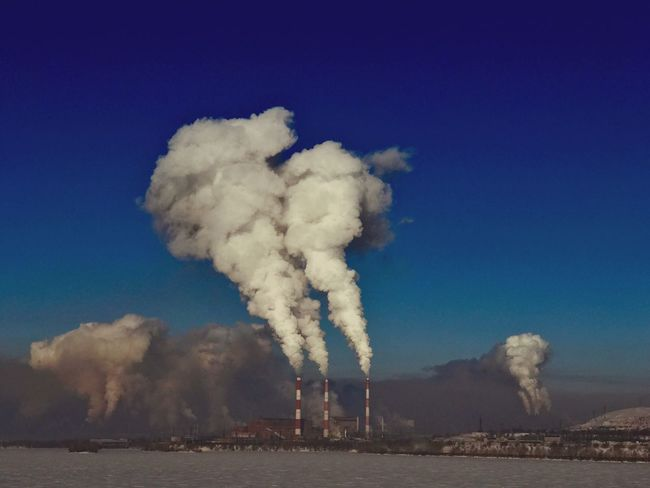 Pollution Factory Industry Air Pollution Smoke Stack Ecosystem  Blue Emitting Smoke - Physical Structure Environment Fumes Environmental Issues Sky Environmental Damage No People Day Water Outdoors Nature Winter Wintertime Air Freshair