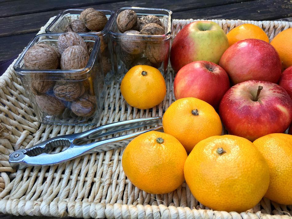Fresh tangerines and walnuts Apples Basket Citrus Fruit Day Detail Diet Diminishing Perspective Food Freshness Fruit Healthy Eating Horizontal Juicy Mandarins Natural No People Nutrition Nuts Orange Orange - Fruit Red Sweet Tangerines Vitamin C Walnuts
