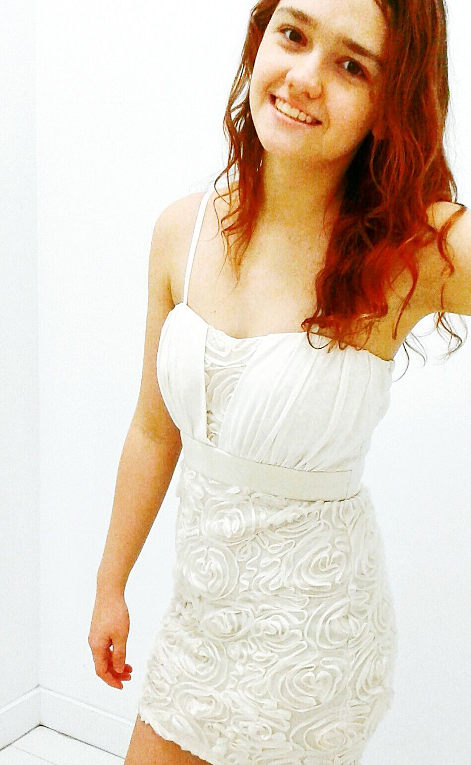 Dressed In White Splash Of Color Red Hair Model