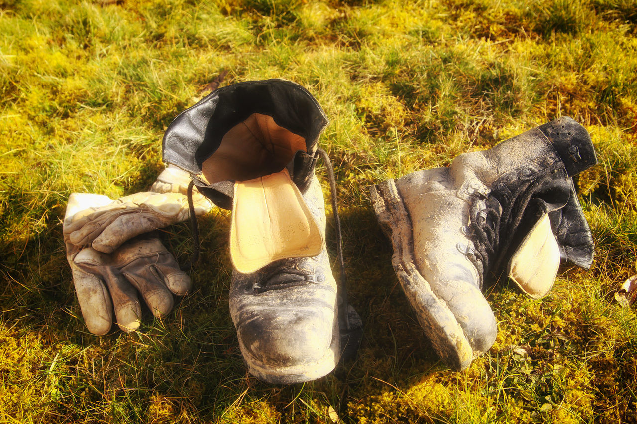 Old shoes Day Field Grass Men Nature Old Shoes One Person Outdoors People Scarecrow Shoes Yellow