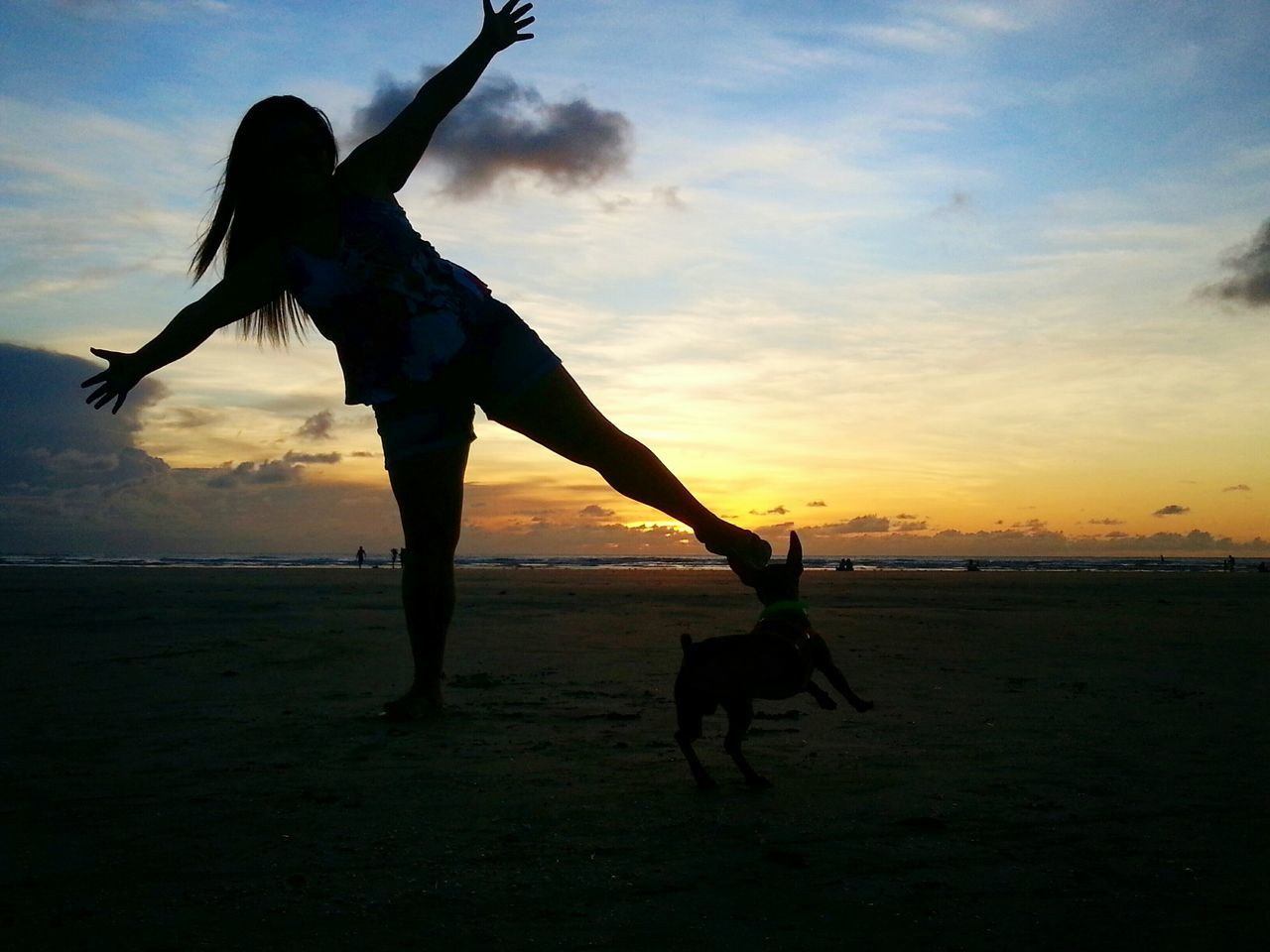 sunset, real people, sky, leisure activity, silhouette, full length, lifestyles, outdoors, cloud - sky, upside down, nature, togetherness, beach, women, handstand, friendship, energetic, day, people