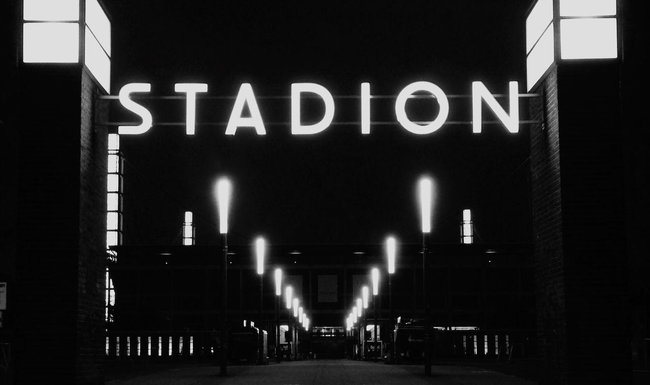 Illuminated Street Lights At Soccer Field