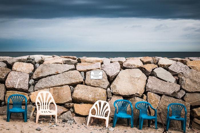Baltic Sea Beach Cloudy Sky Day Garden Chair Horizon Over Water In A Row Kaimauer Kap Arkona Lawn Chair No People Plastic Stool Quay Wall Rügen Sea Side By Side Tristesse Vitt Water