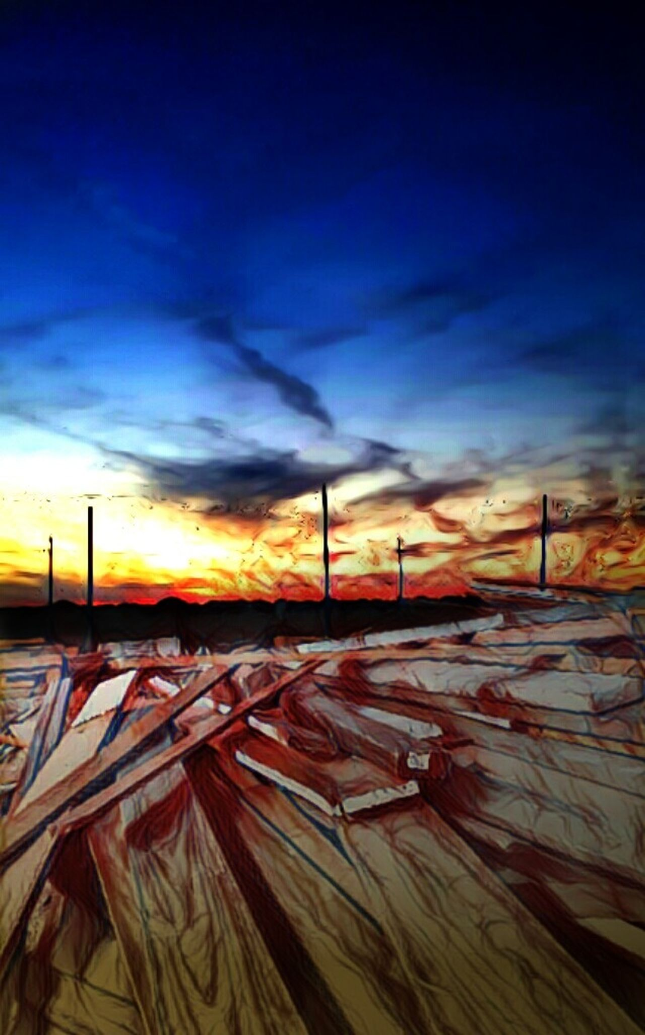 Lumber Land. Sky Cloud - Sky Sunset Cold Temperature Power Line  Road Tranquil Scene Dramatic Sky Outdoors Winter Surrealist Art Mysterious Surreal Strange Things Weird Landscape Lumber, Timber, Planks, Planking; Logs, Sawlogs Woodpile Noirphoto