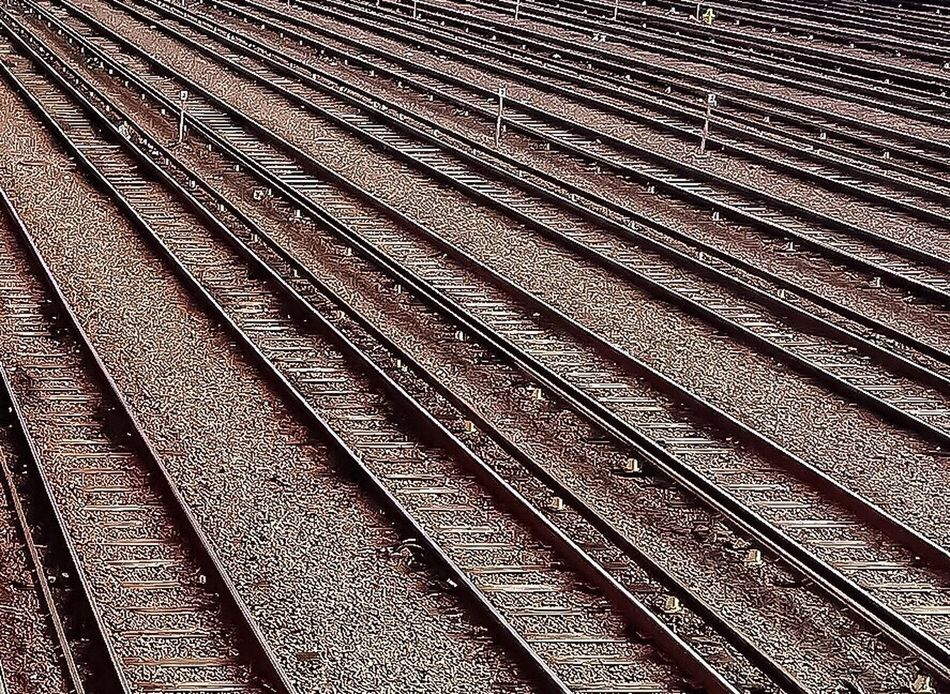 Railroad Track Rail Transportation Outdoors Full Frame Stone Material No People Endoftheline Lines Triangles Geometry Gravel Textures And Surfaces Nikon Urban Geometry Transportation EyeEm Best Edits The Way Forward Shades Of Grey Day