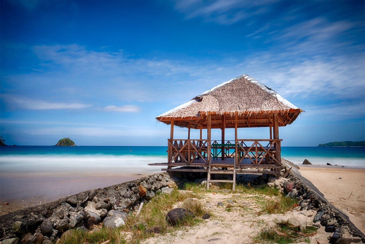 Sea Sky Water Horizon Over Water Architecture Built Structure Beach Nature Cloud - Sky Thatched Roof Beauty In Nature Scenics Tranquility Day Stilt House Blue Island Travel Destinations HDR Tropical Travel Long Exposure Seascape Outdoors No People Neighborhood Map