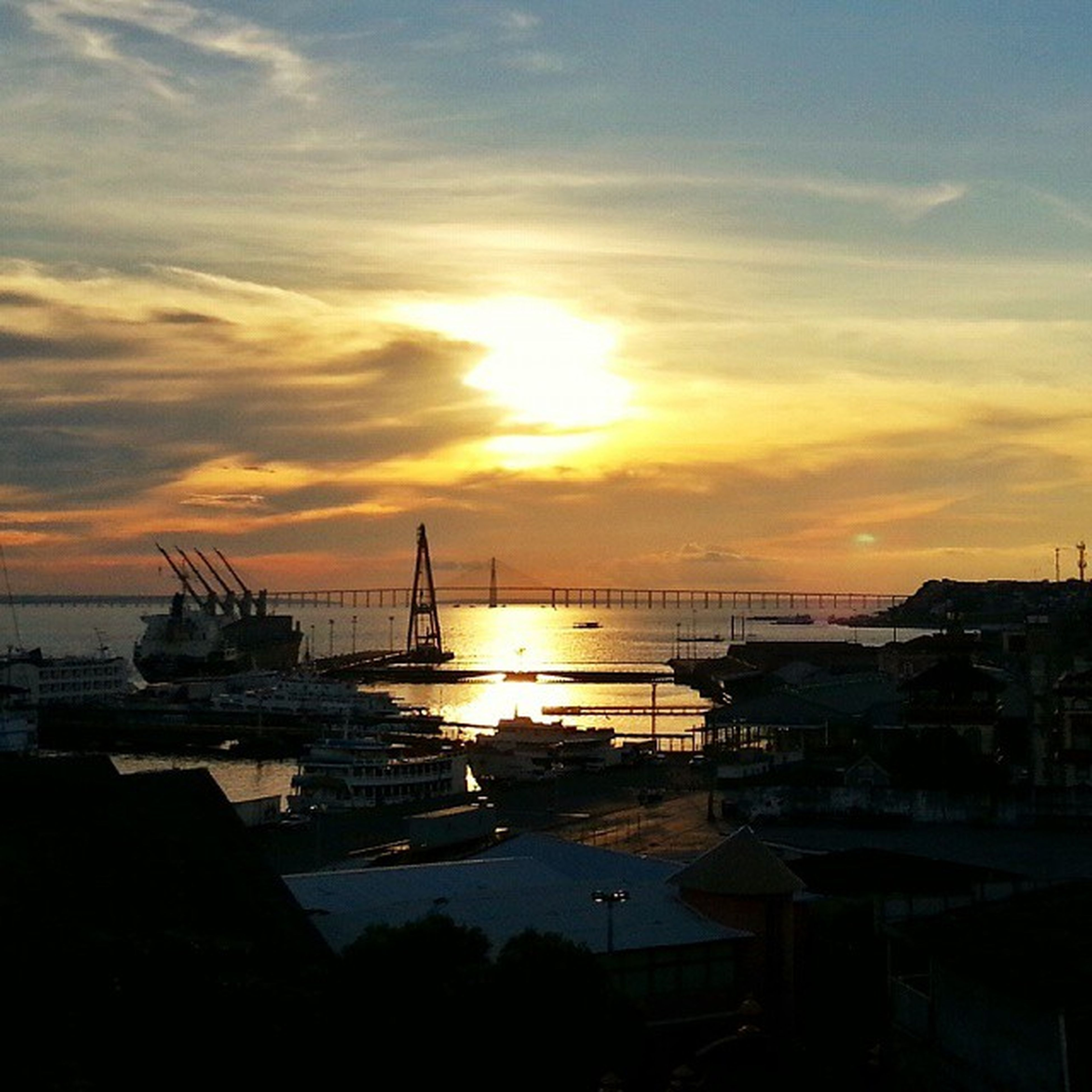 sunset, water, nautical vessel, transportation, sea, orange color, sky, mode of transport, silhouette, sun, boat, cloud - sky, beauty in nature, harbor, scenics, moored, built structure, nature, architecture, tranquil scene
