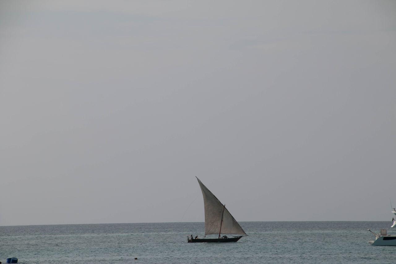 Dhow fishing boat in Zanzibar Day Horizon Over Water Nature Nautical Vessel No People Outdoors Regatta Sailboat Sailing Sailing Ship Sea Sky Water Yacht Yachting