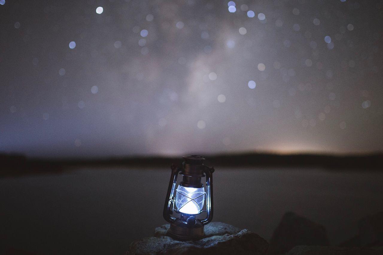 Oil Lamp Against Sky At Night