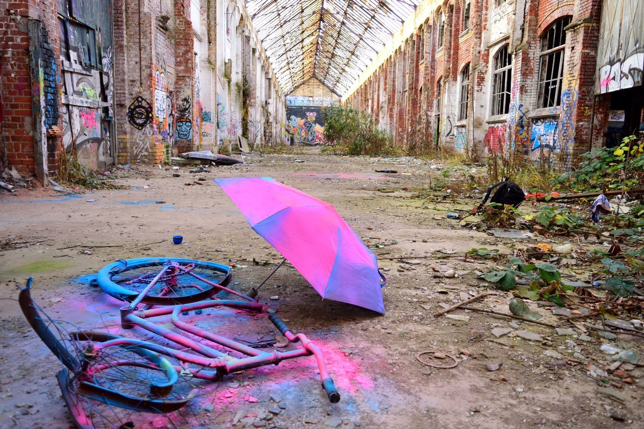 A ruin in Plagwitz, Leipzig Abondoned Buildings Architecture ArtWork Bike Blue Building Exterior Built Structure City Day Enjoying Life Germany Leipzig Multi Colored No People Nostalgia Outdoors Pink Pink Color Ruined Building Umbrella