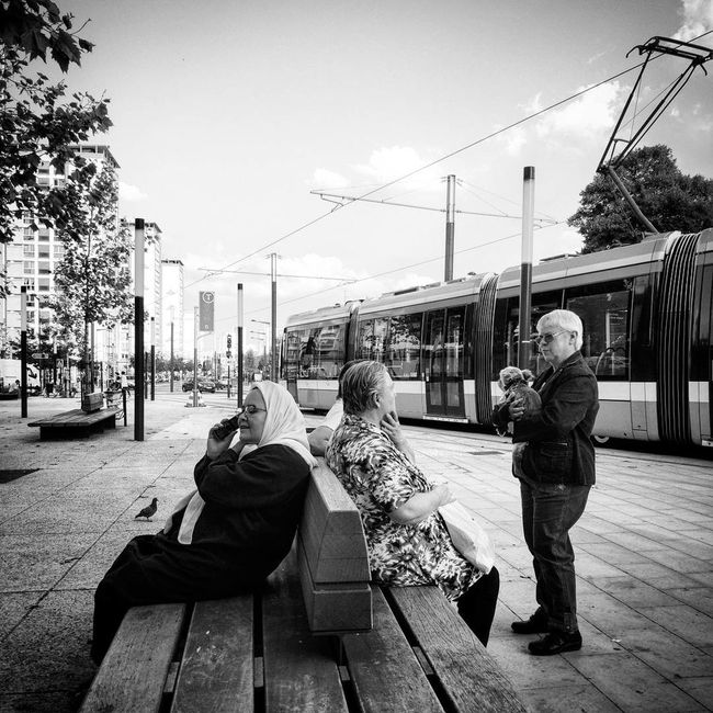 People speak Peoplephotography People Photography Lifestyles Outdoors City Life Streetphotography Street Photography People And Places Station Train Tramway City Bench