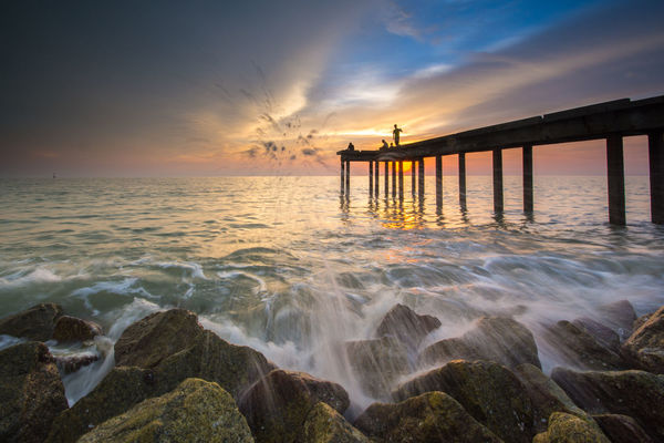 Sunset at the beach Fishing Holiday Jetty Long Exposure Malaysia Ocean Rock Scenics Sea Seascape Splash Sunset Water Wave Wood Miles Away Live For The Story BYOPaper!