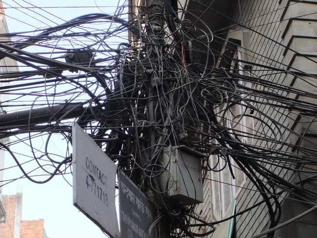 Cazy City Comotion Entwined Knotted Messy Nepal Power Line  Tangled