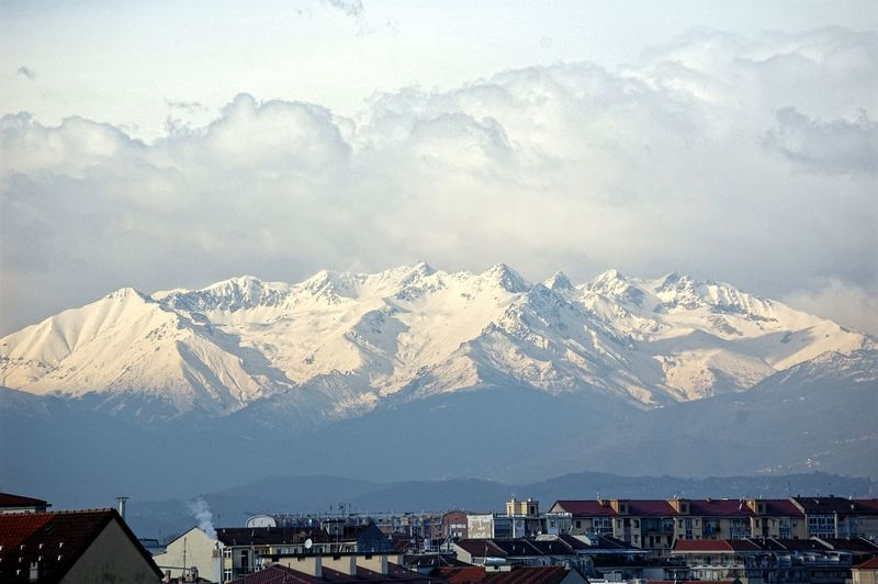 At the foot of the Alps Turin From The Balcony My City Beauty In Nature Mountian View Clouds And Sky Shades Of Winter Mountain Snow Mountain Range Winter Snowcapped Mountain No People Landscape Cold Temperature Outdoors Sky