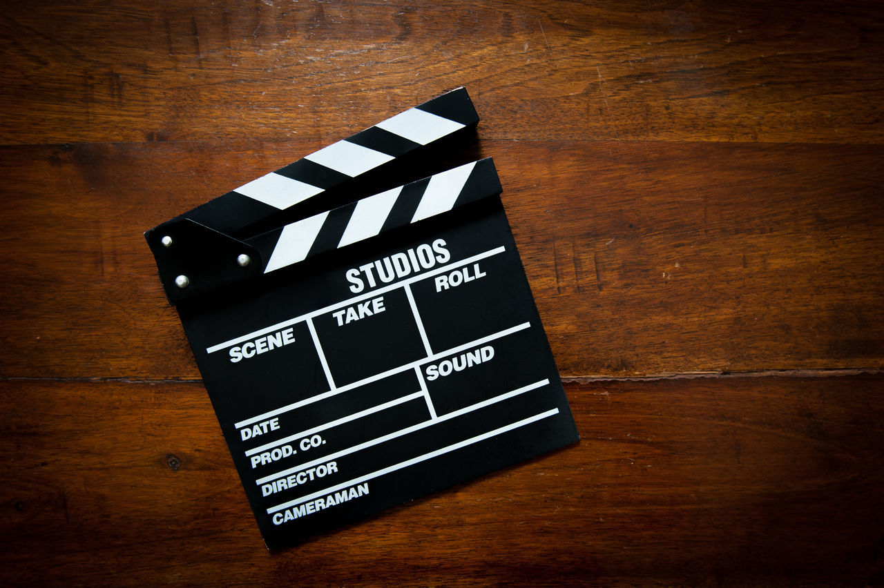 Movie clapper board on wooden table Cinema Clapper Clapper Board Close-up Day Film Industry Indoors  MOVIE No People Wood - Material