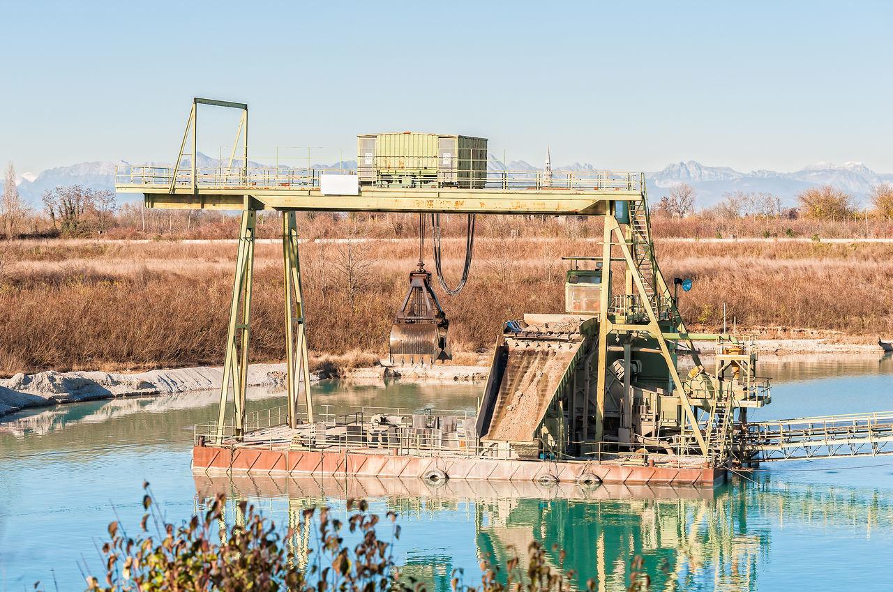 Gravel pit. Technology for extraction of gravel from a quarry filled with water. Construction Conveyor  Day Digging Excavation Extraction Gravel Industry Machinery Natural Disaster Outdoors Picoftheday Quarry River Sky Water