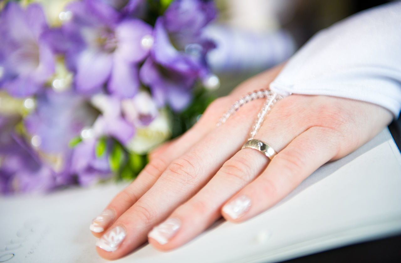 Beautiful bride's hand with manicure in white glove Adult Beauty Bouquet Of Flowers Bridal Bride Close-up Diamond Ring Flowers Human Body Part Human Hand Jewelry Manicure One Person People Ring Selective Focus Wedding Wedding Ceremony Wedding Ring Women