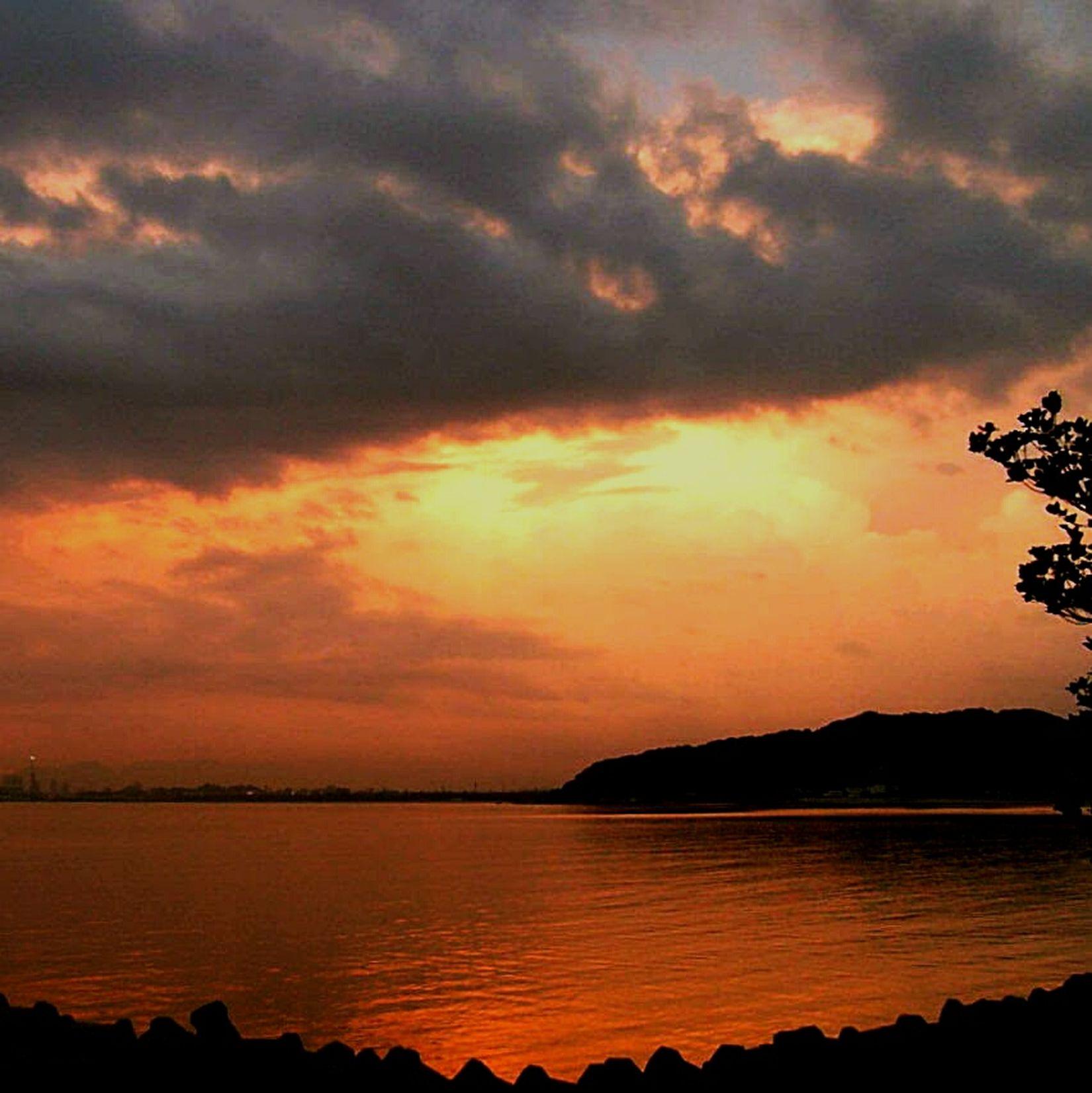 SillhouetteofFukuoka City  ImajukuBay Sunrise 2006 from my kitchen window. Phoneography Cellphone Photography
