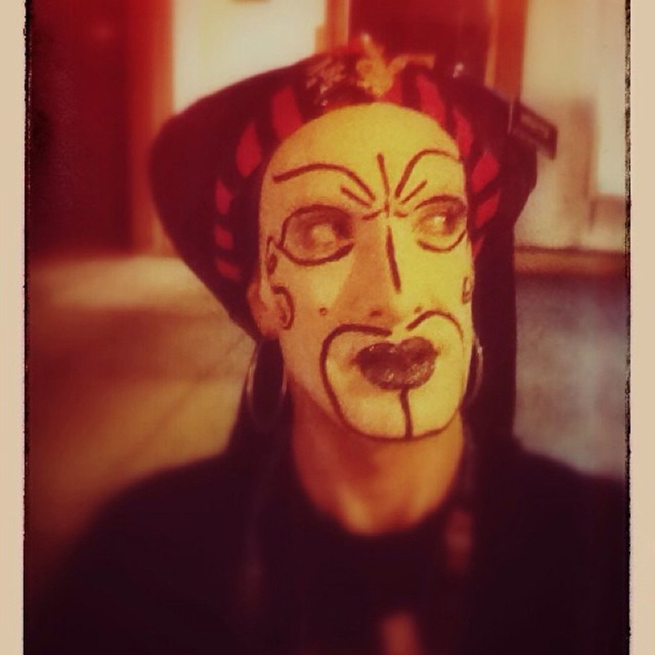 one person, front view, disguise, indoors, spooky, home interior, face paint, looking at camera, halloween, real people, portrait, headshot, anthropomorphic face, close-up, lifestyles, young adult, one man only, night, clown, only men, adults only, people, adult