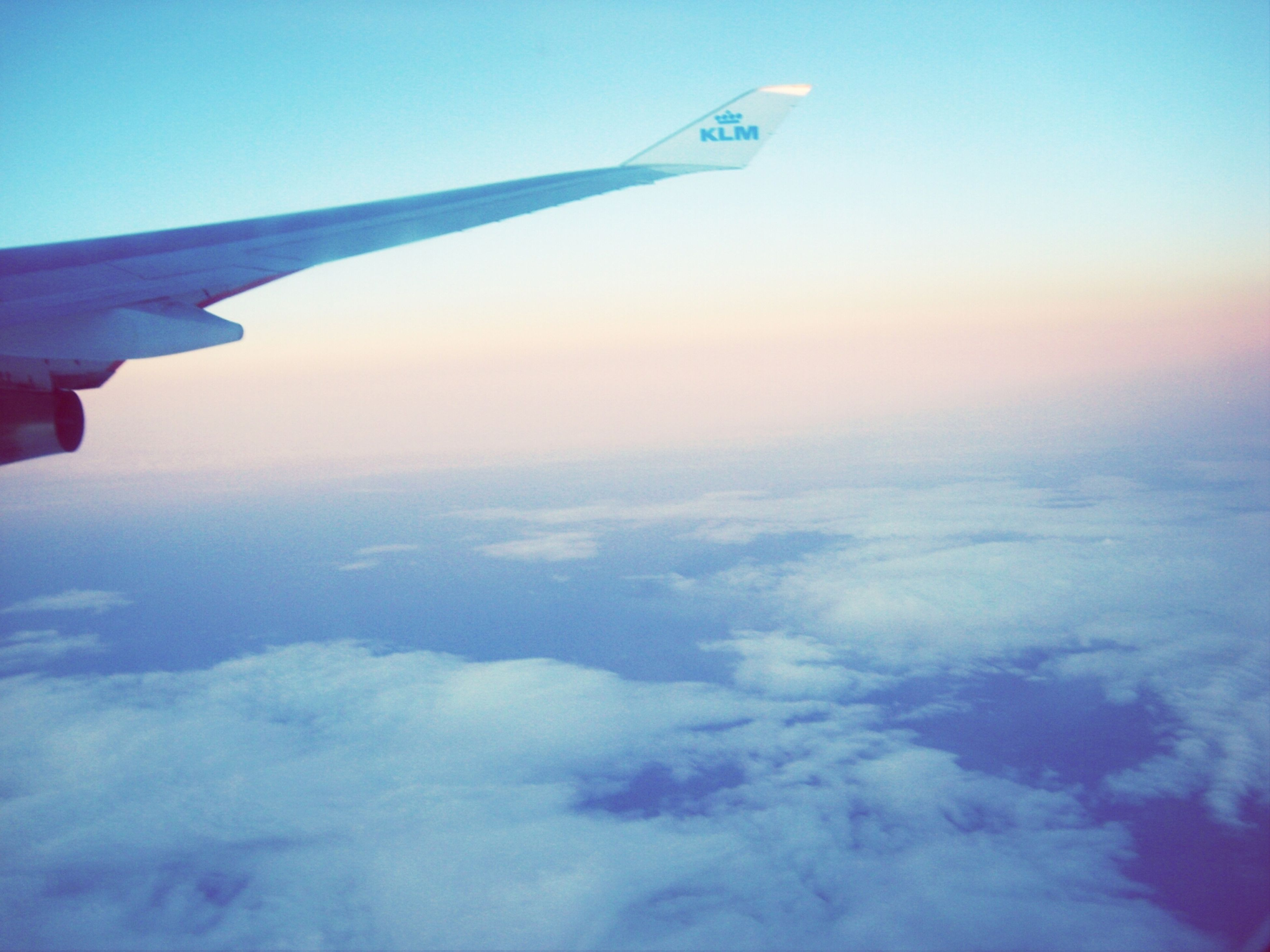 airplane, flying, air vehicle, aircraft wing, transportation, blue, mode of transport, sky, part of, cropped, scenics, mid-air, beauty in nature, travel, aerial view, nature, cloud - sky, tranquility, tranquil scene, journey