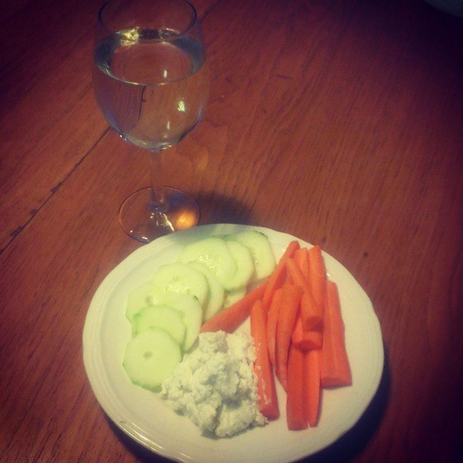 I'm not terribly hungry, so I'm having #sliced #cucumber, #carrots, a #veggiedip made from #greekyogurt and a glass of #arbormist #chardonnay for a light #dinner. Healthyfood Eatclean Dinner Lowfat Wine Greekyogurt Wino Arbormist Fitness Lowcalorie Diet Eatright Weightloss Veggiedip Fit Winesnob Cucumber Lowcal Lowcarb Nylonsnack Chardonnay Fitsperation Carrots Sliced Fitspo Whitewine