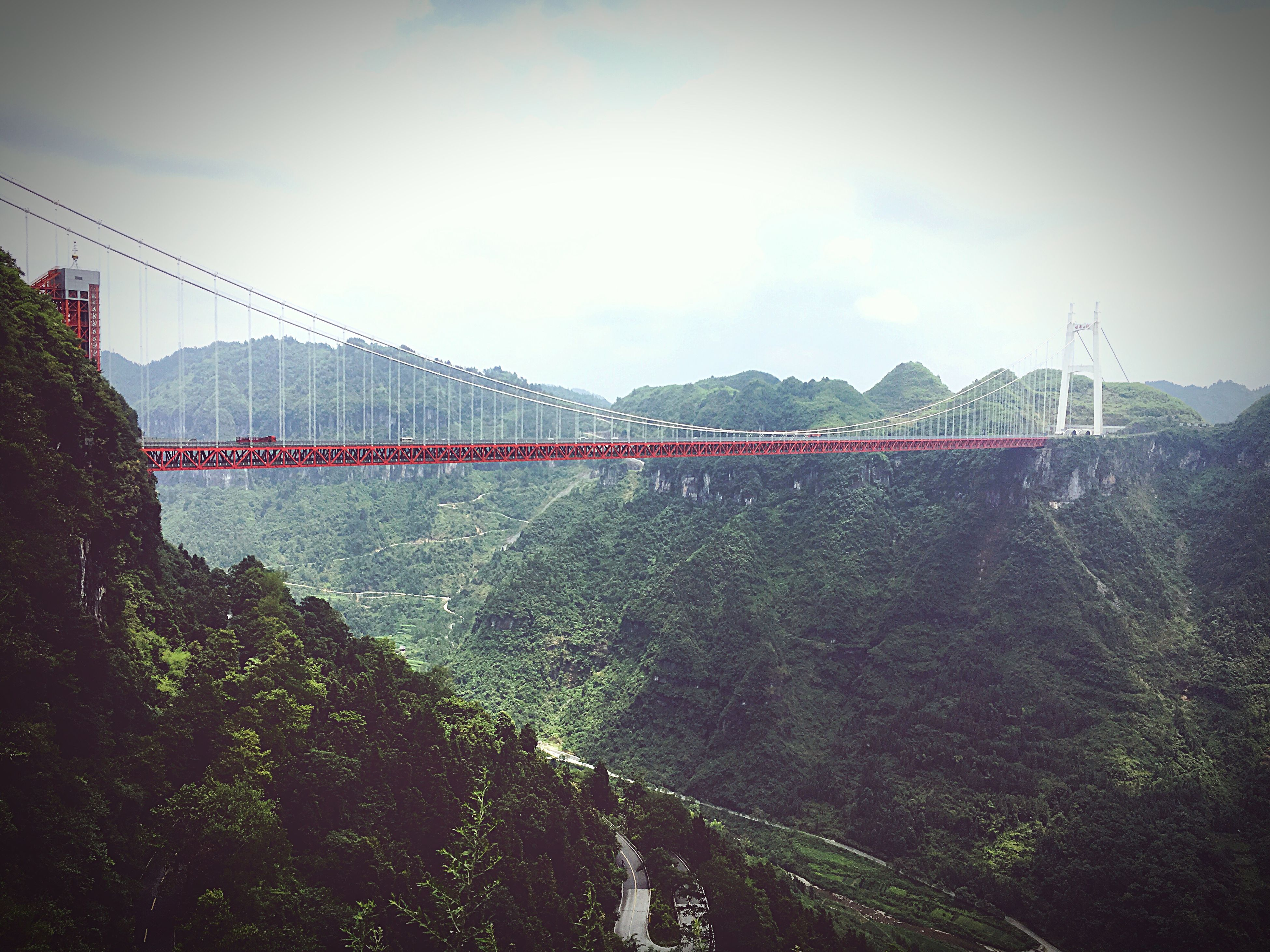 architecture, built structure, water, connection, bridge - man made structure, sky, suspension bridge, river, engineering, city, outdoors, nature, travel destinations, day, no people, cloud - sky, tranquility, scenics, cloud, development, tranquil scene, tourism, beauty in nature