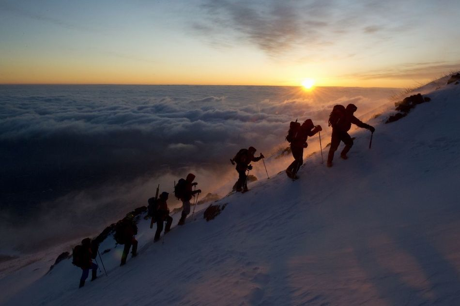 Sunrise at Mt Fuji. An international team of climbers from the organisation Greenpeace on their way to the summit for a manifestation against nuclear power in support of the victims of the Fukushima nuclear disaster. Capture The Moment Mountains Mountaineering Above The Clouds Adventure Landscape People Mt Fuji Traveling Nature_collection