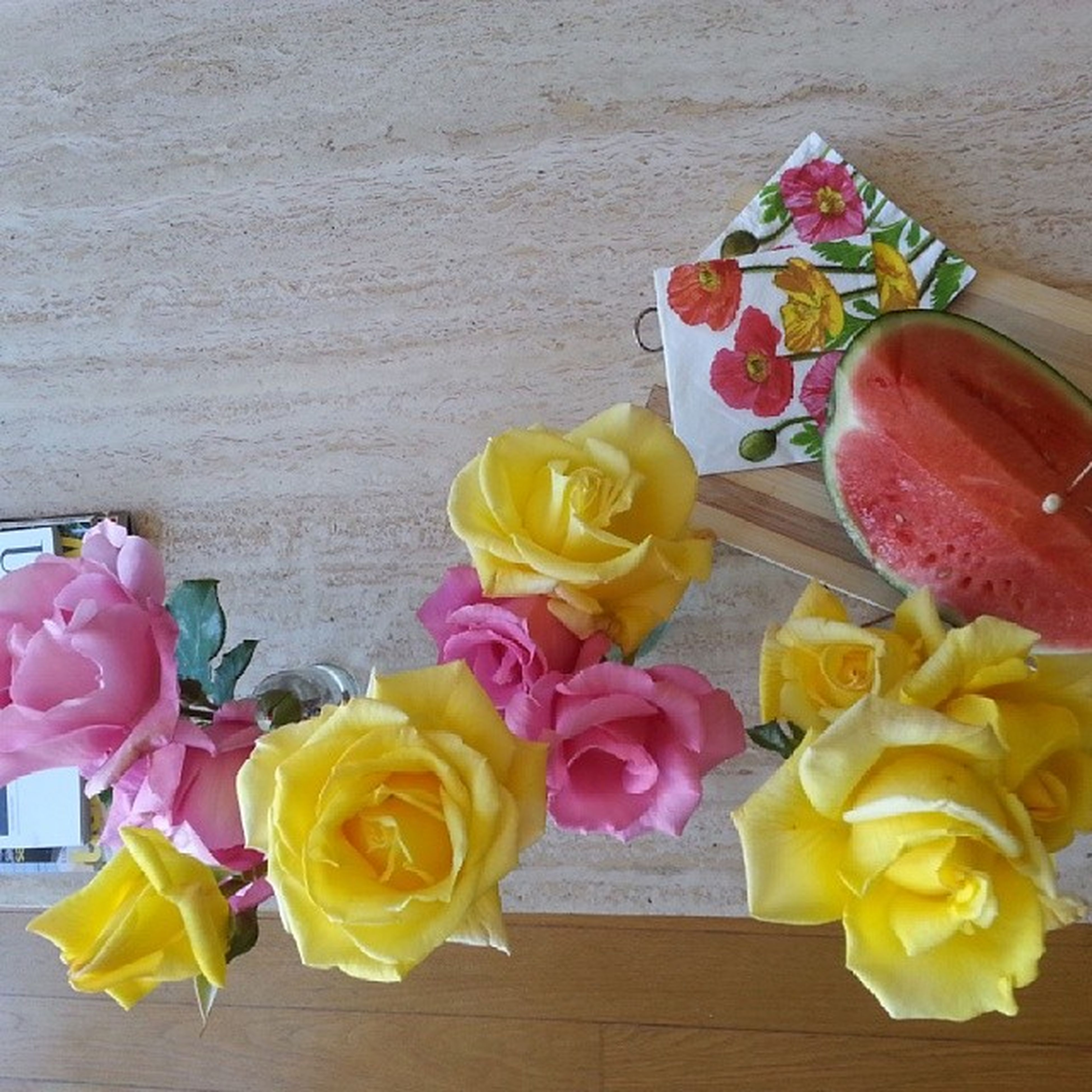 freshness, flower, yellow, table, still life, multi colored, food and drink, indoors, petal, variation, food, high angle view, fragility, flower head, sweet food, rose - flower, vase, fruit, close-up, no people